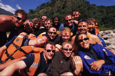 The team on a hike into the river during the 14 day Dashain Festival