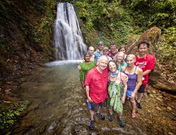 Image of group in front of waterfall on the Karnali river