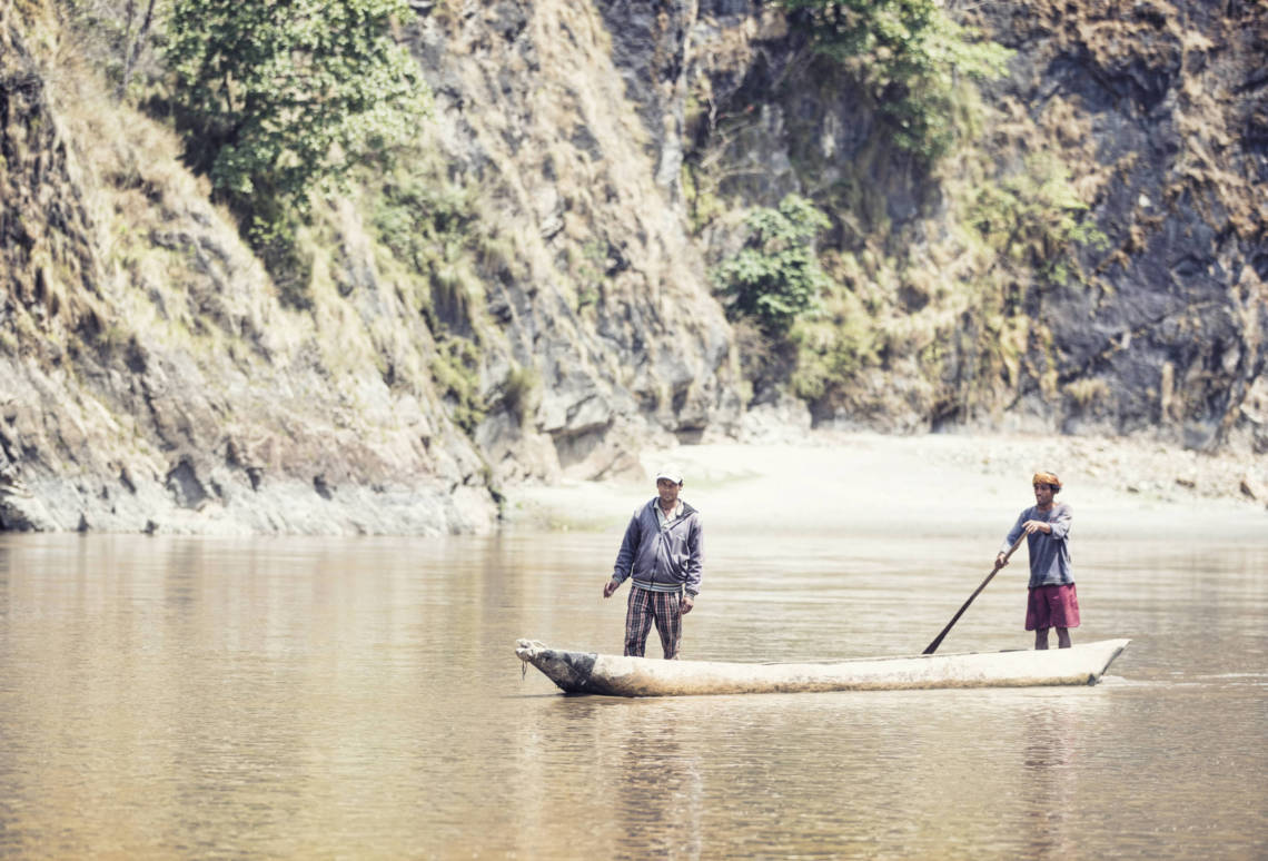 Image of traditional Nepali boat (dunga) on Karnali River
