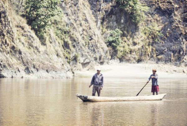 Image of traditional Nepali boat (dunga) on Karnali River