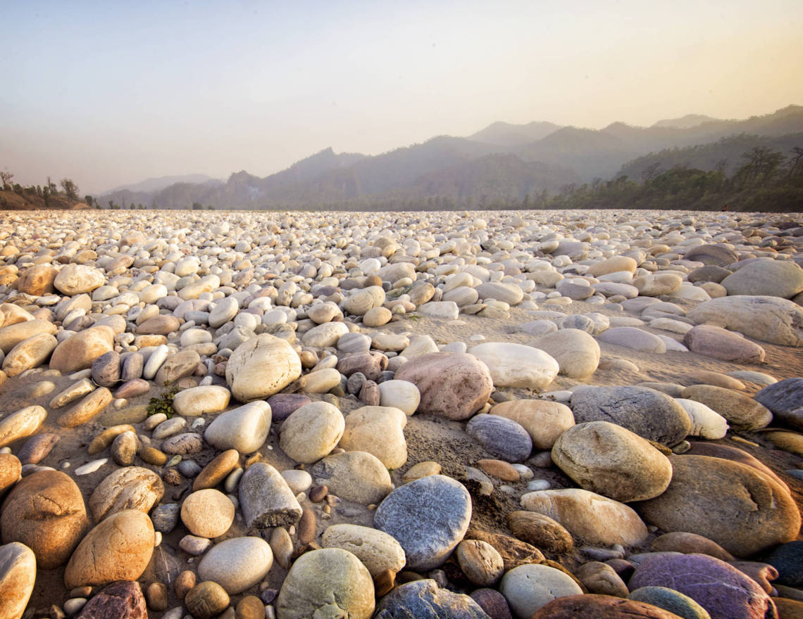 Image of river stones in light on Karnali River