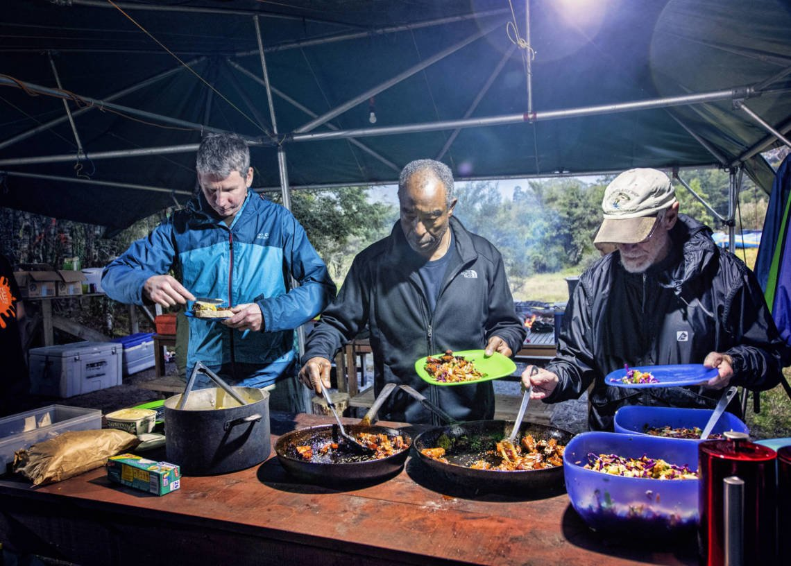 Image of clients serving themselves food on the Landsborough River