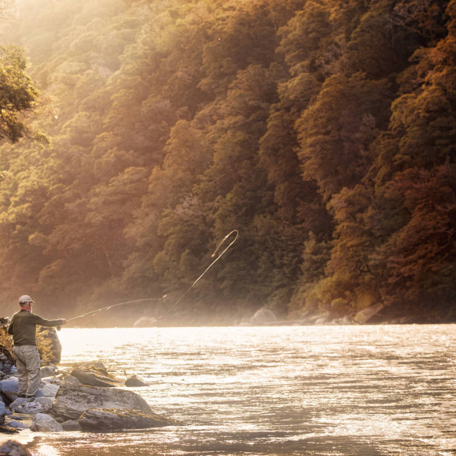 Image of man fly fishing in New Zealand