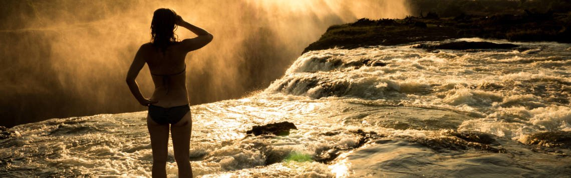 Image of girl looking at Devils Pool on Livingstone Island Zambia